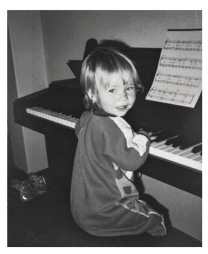3 year old Teagan at her first piano